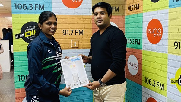 Radio Suno 91.7 FM Managing Director Mr. Ameer Ali Paruvally Handing Over Radio Olive and Radio Suno Annual Newsletter to Ms Tintu Lukka, The Indian Olympian Star who represented India in the 2012 and 2016 World Olympics, during her studio visit to celebrate the Qatar National Sports Day 2020.