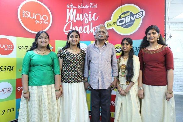 Sreekumaran Thampi being welcomed by budding singers of Qatar